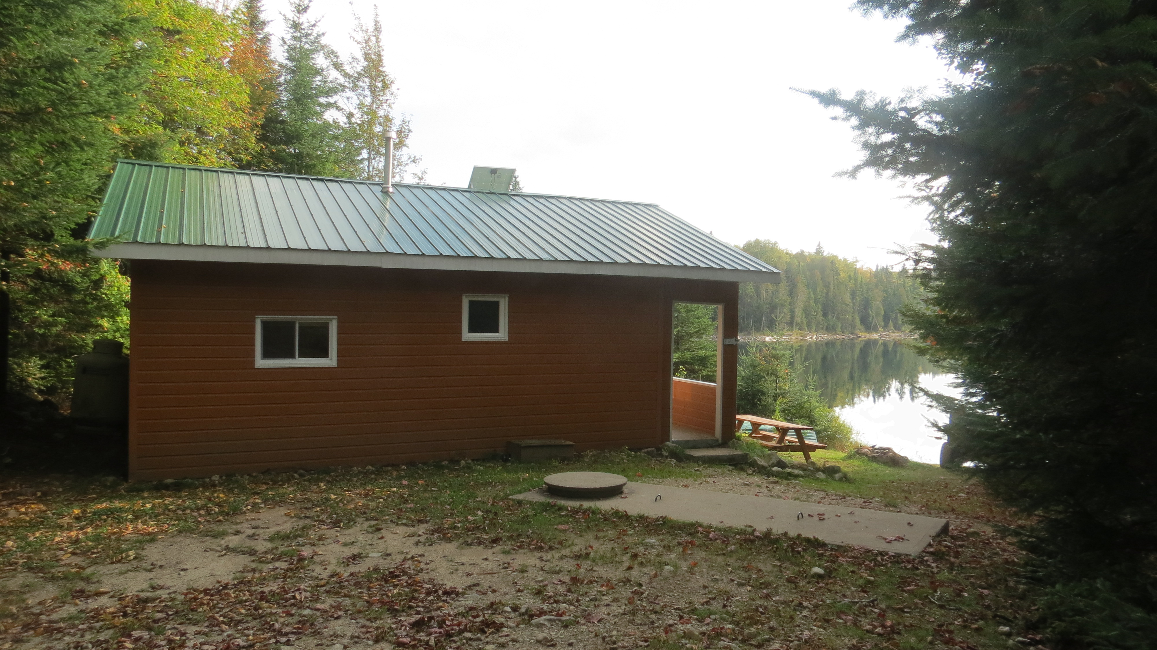 Summer cabins warmed with stove, veranda and shower